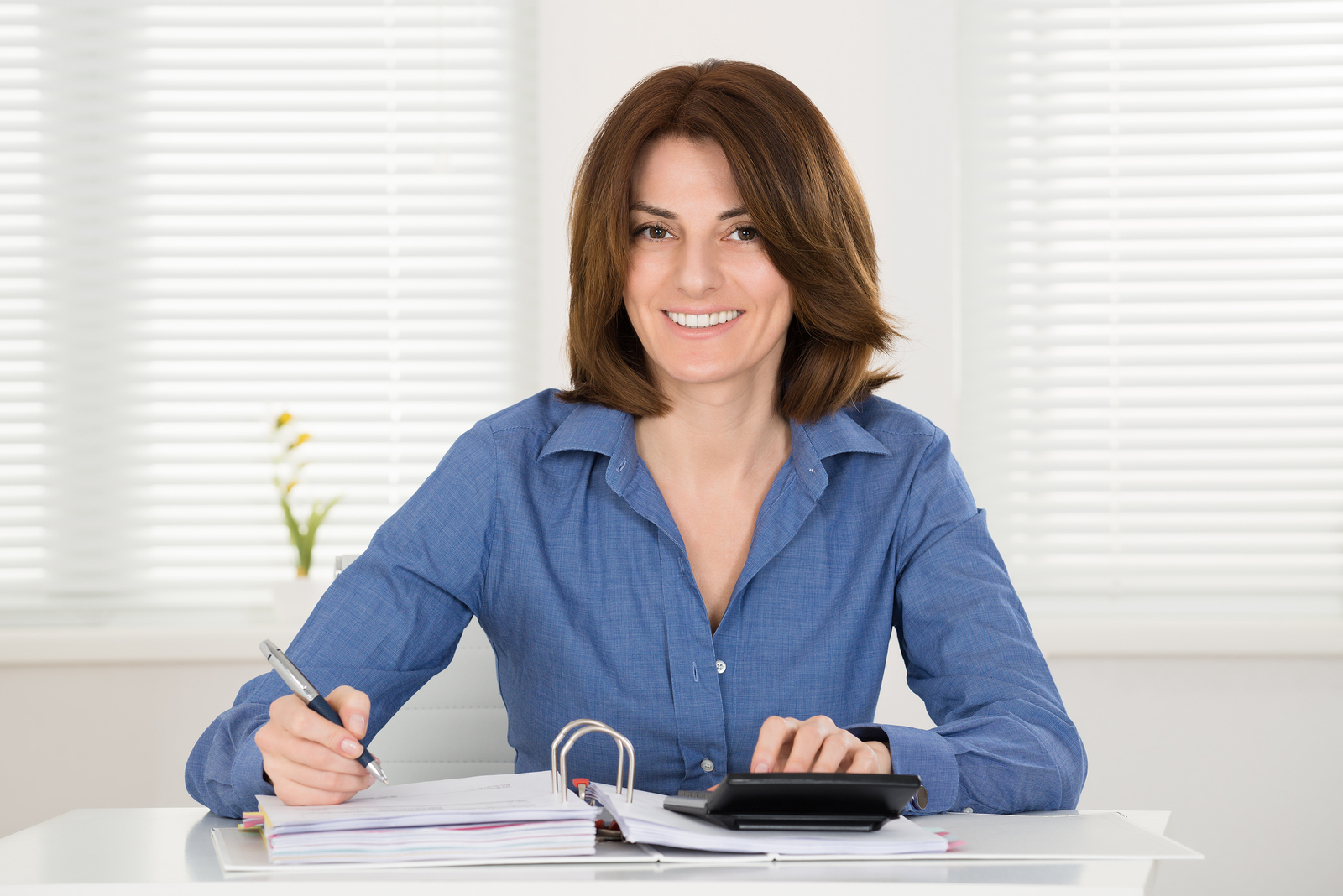 Young Happy Businesswoman Calculating Bill At Home